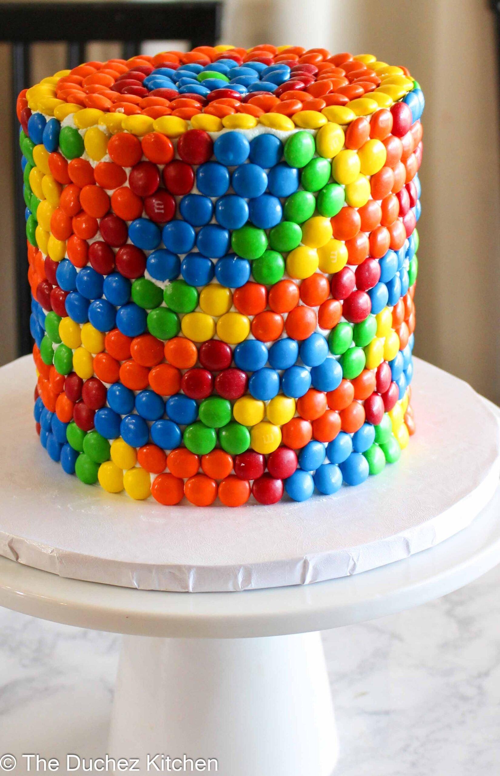 Rainbow cake on a stand